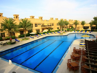 Отель Al Hamra Village Golf & Beach Resort 4* Рас Аль-Хайма ОАЭ