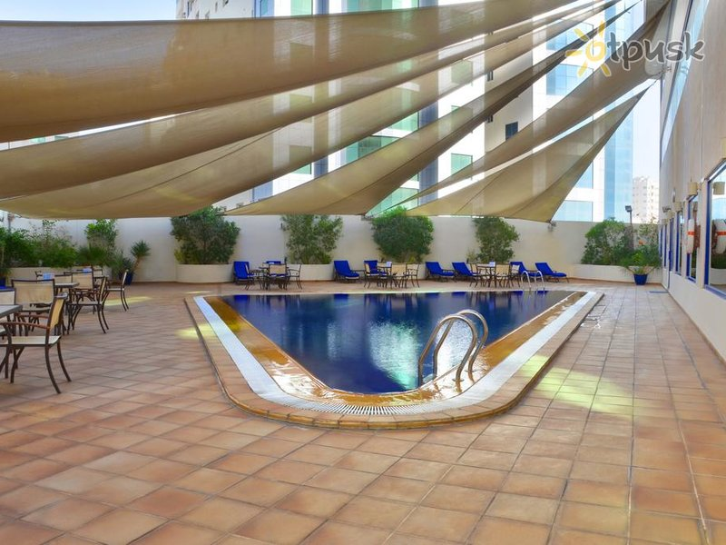 Отель Swiss-Belhotel Sharjah 4* Шарджа ОАЭ